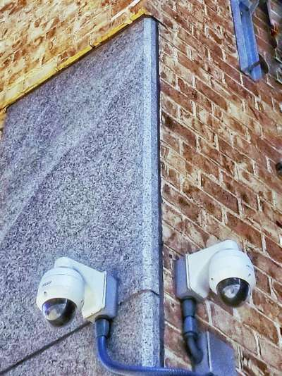 Security Cameras mount on the corner of the building